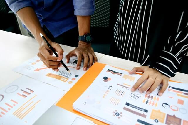Two people looking at analytics to measure customer satisfaction