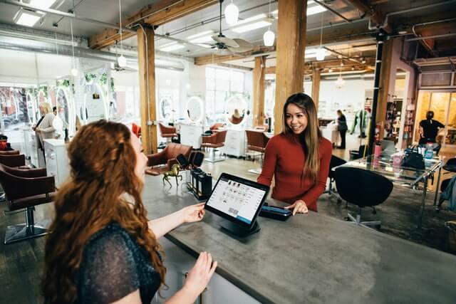 Two people discussing customer feedback metrics at work.