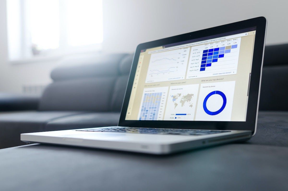 A laptop displaying data and graphs on a data visualization tool.