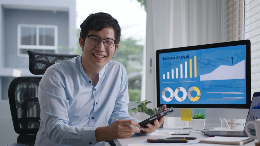 Happy professional happy about his CX metrics going up